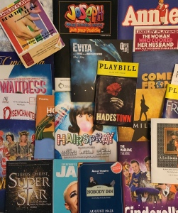 About 20 theatre programmes scattered atop each other.