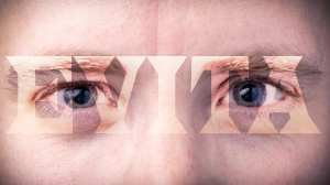 A close-up of a pair of eyes, with the word EVITA written across them.