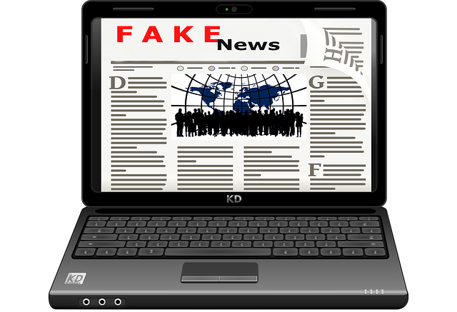 "A laptop computer displaying a web page with the word ""Fake News"" as the banner."